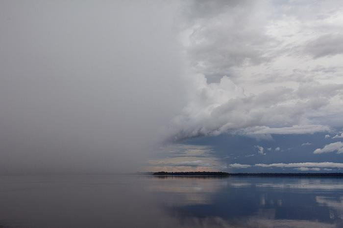 Storm brewing over the Rio Negro, Amazon, Brazil by Carolyn Monastra